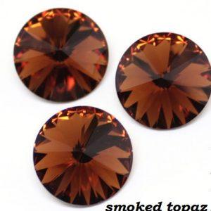 361fd75442ac1592a0e418d971zc--materialy-dlya-tvorchestva-rivoli-svarovski-12mm-smoked-topaz